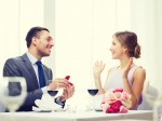 man proposing to his girlfriend at restaurant